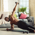 African-american Man Teaching At Home Online Courses Of Fitness,